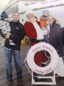 Santa with the Ellertsons Photo: Argosy Cruises