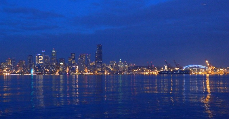 Downtown-12th-Man-in-lights-and-CenturyLink-Field-illuminated-on-the-right---Sarah-Minaker_resize