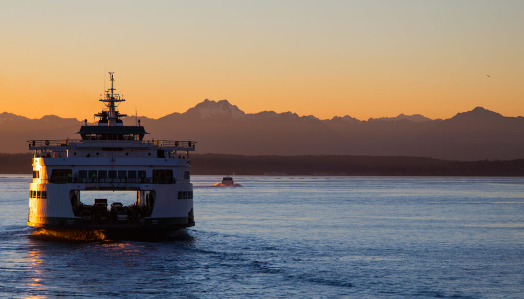 Washington State Ferry heading toward the Olympic Mountains across Puget Sound