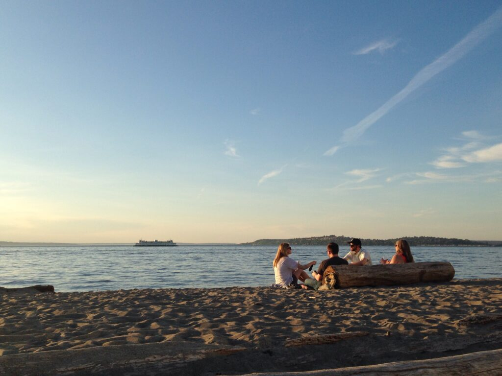 Lounging on the sand at Alki Beach Park – a favorite summer pastime.
