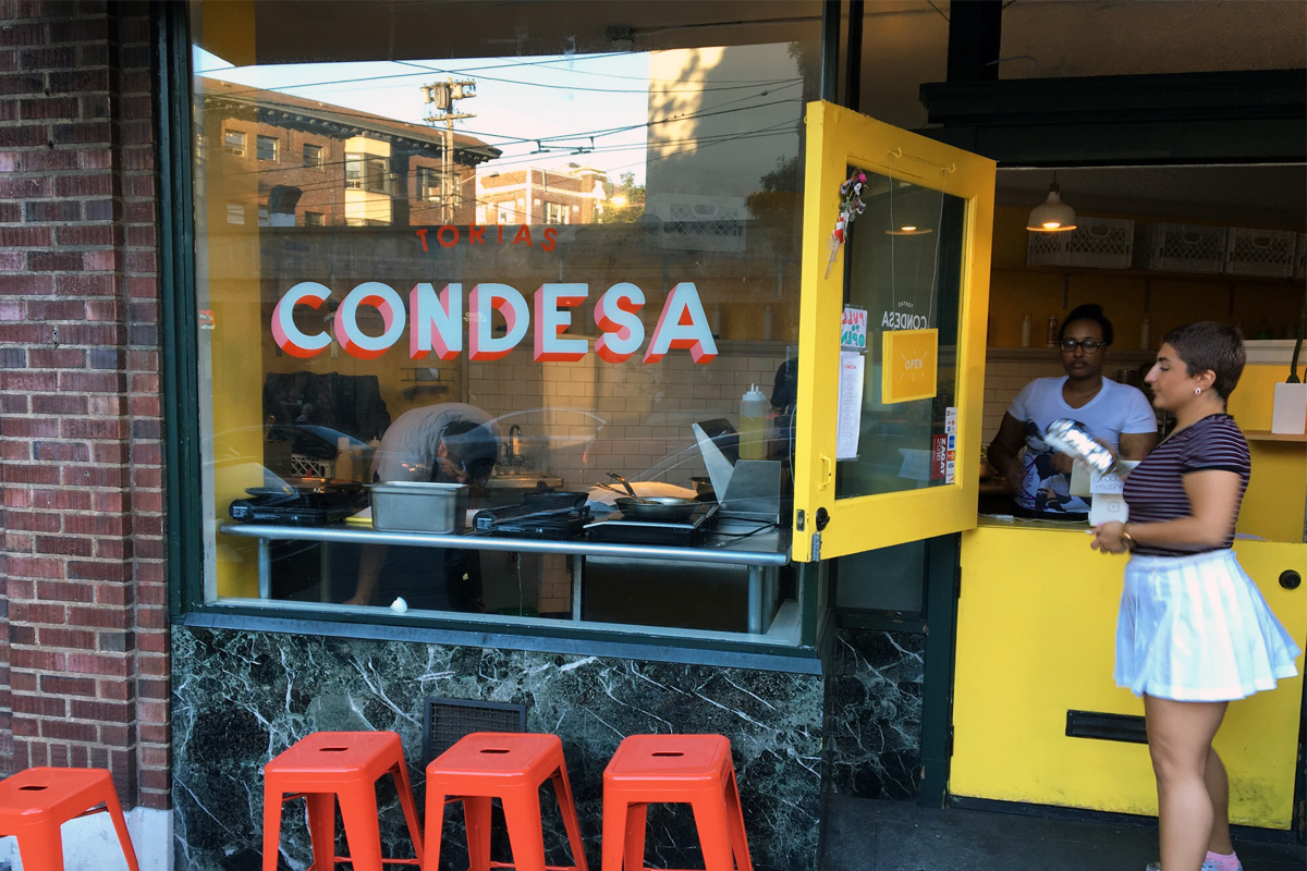 The sweet, yellow exterior of Tortas Condesa.