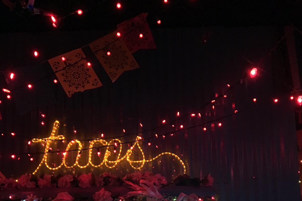 Neon Taco's sign illuminates the darkness of Nacho Borracho.