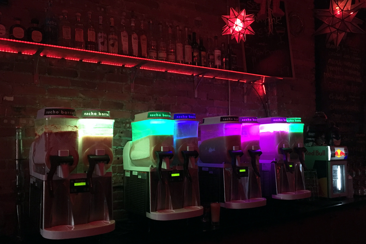 These machines are churning delicious adult slushies that go perfectly with spicy Mexican food.