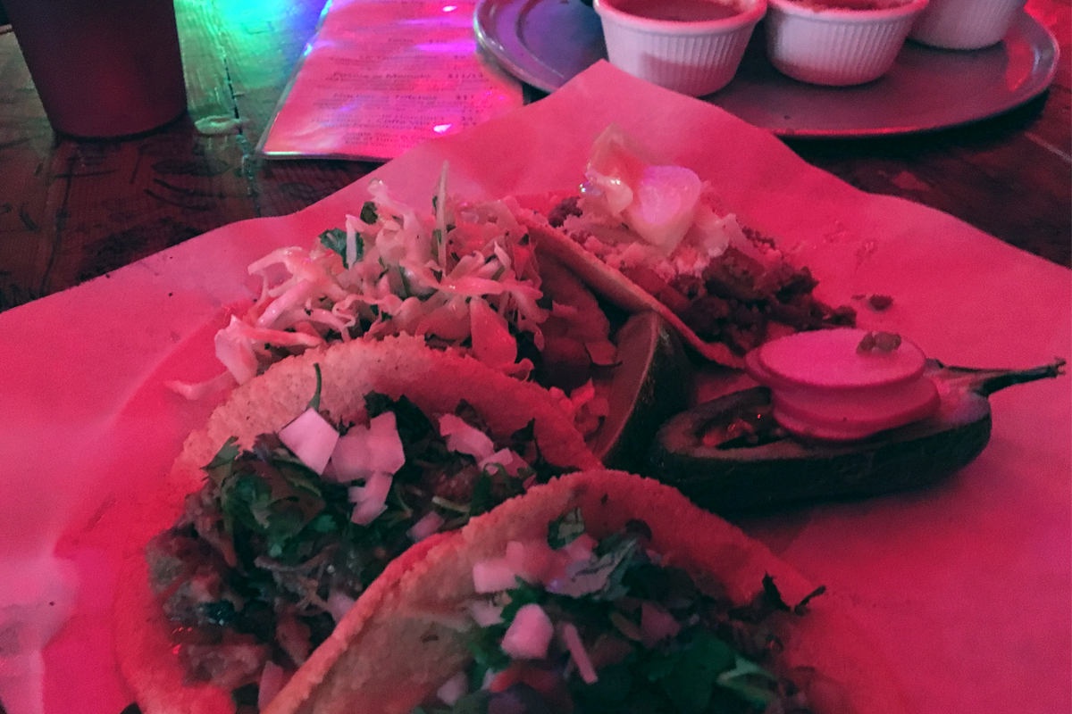 From left: two carnitas tacos, one crispy pork belly and one chorizo.