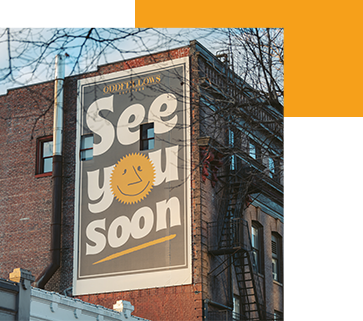 """Signage outside of George's Deli that reads, """"See you soon."""""""