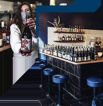 Interior shot of the bartop and wine bottles at La Dive