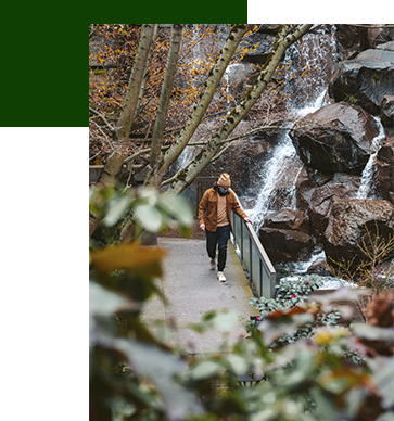 Image of man walking in the Waterfall Garden in Pioneer Square